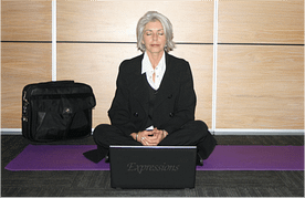 Meditating on a yoga mat - Yoga will boost your career