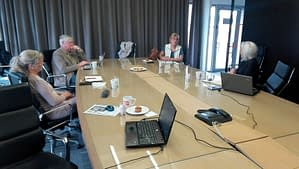 Picture of mastermind members sitting around a conference table.